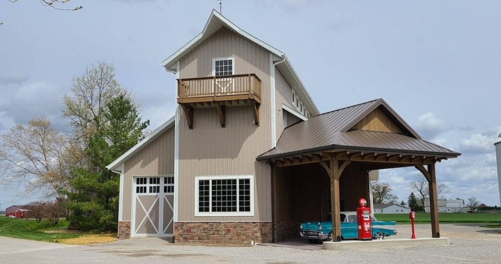 Two Story Barndominium Project with cool old blue car in front